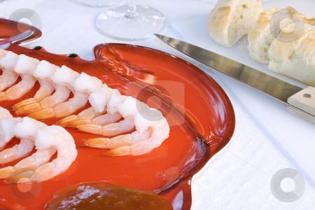 Shrimps on a Plate stock photo, Close up - Shrimps on a Plate with sliced Bread on the background by Mehmet Dilsiz