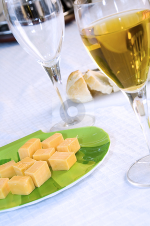 Close up on a plate of cheese with Wine Glasses stock photo, Angle Shot of a plate of cheese with Wine Glasses by Mehmet Dilsiz