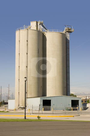 Silo with the Storage Barn in the Front stock photo, Silo with Clear Skies and Storage Barn in the Front by Mehmet Dilsiz