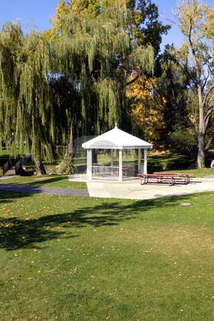 White Gazebo in the Park stock photo, A Gazebo surrounded by Trees in a Park by Mehmet Dilsiz