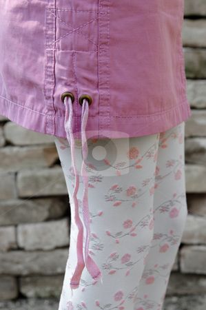 Female Fashion stock photo, Fashion detail of female model wearing pink mini skirt and embroidered legwear with bricks in background by Milsi Art