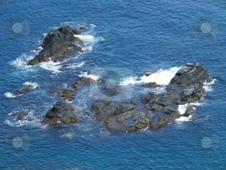 Rocky Crag In The Ocean stock photo, A view from the rocky coastline of newfoundland canada by CHERYL LAFOND