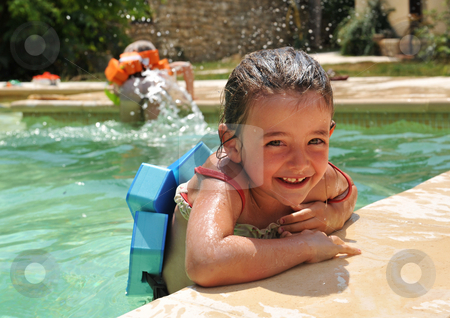 Little girl in swimming pool stock photo, Smiling little girl in a swimming pool by Bonzami Emmanuelle