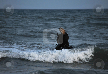 Riding woman in sea by night stock photo, Young woman an her black stallion swimming in the sea at night by Bonzami Emmanuelle