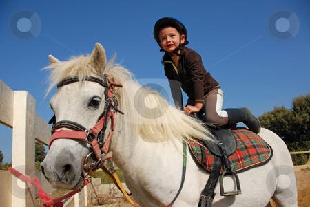 Little girl and shetland stock photo, Happy little girl and her friend white purebred shetland pony by Bonzami Emmanuelle