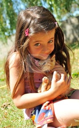 Little girl and kitten stock photo, Little girl and kitten in a garden by Bonzami Emmanuelle