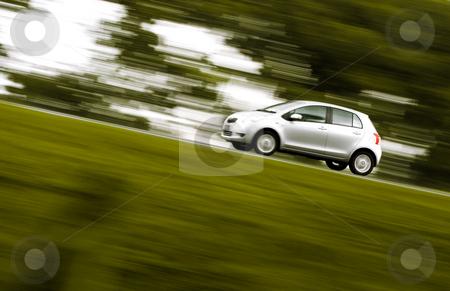 Speedy car rushing away stock photo, Silver car rushing away on a countryside road by R. Eko Bintoro