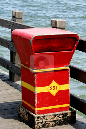 Trash bin on the beach stock photo, Conceptual portrait of a trash bin on the beach by R. Eko Bintoro