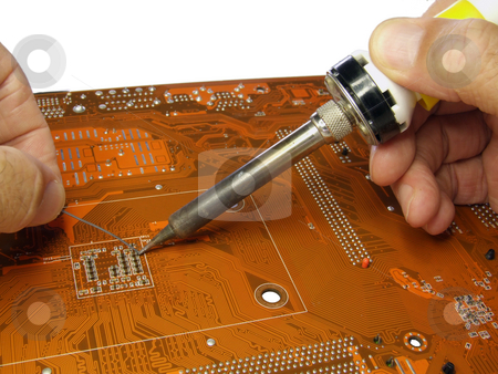 Soldering in progress stock photo, Soldering small component on printed circuit board by Stuart Atton