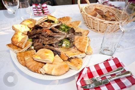 Lamb Ribs stock photo, Grilled lamb ribs with pita bread and vegetables. by Mariusz Jurgielewicz