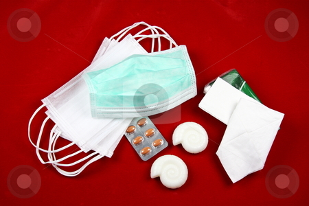 A-H1N1 Swine Flu Essentials stock photo, The essentials for preventing the spread of the A-H1N1 Swine Flu Virus - masks, antivirals, hand-soap and tissues on a red background indicating a warning. by Gozzoli