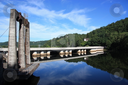 Hydroelectricity Renewable Energy stock photo, A hydroelectric barrage on the Dordogne River, France forms a perfect reflection in the early morning sun. by Gozzoli