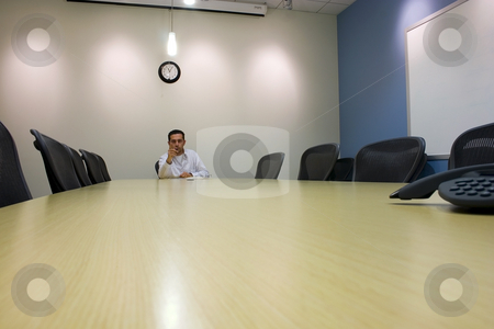 Businessman in a Conference Room  stock photo, Businessman pointing in a Conference Room by Mehmet Dilsiz