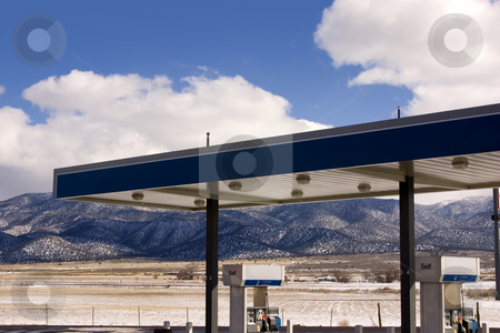 Gas Station and Cloudy Skies stock photo, Gas Station with fields and Mountains on the background by Mehmet Dilsiz