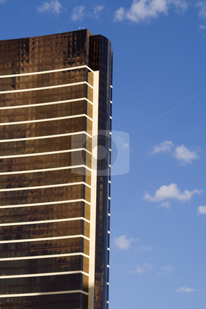 Front of the Mirrored Business Building stock photo, Close up on a Mirrored Business Building by Mehmet Dilsiz