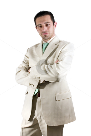 Businessman posing with his arms crossed stock photo, Isolated Businessman posing with his arms crossed in a white suit by Mehmet Dilsiz
