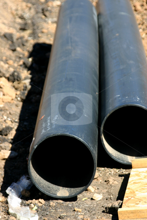 Pipes stock photo, Two Pipes lying by Mehmet Dilsiz