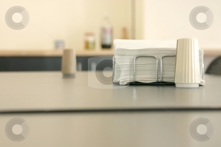 Napkin and Salt in a Cafeteria stock photo, Close up on the Napkin and Salt in a Cafeteria by Mehmet Dilsiz