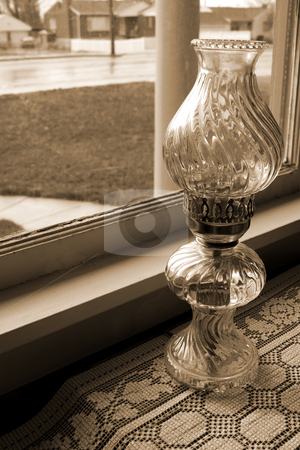 Antique Lamp by the Window stock photo, Antique Lamp by the Window in an old House by Mehmet Dilsiz