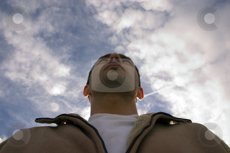 Man Looking up with the Clouds on the Background stock photo, Man Looking up with the Clouds and the Blue Skies on the Background by Mehmet Dilsiz