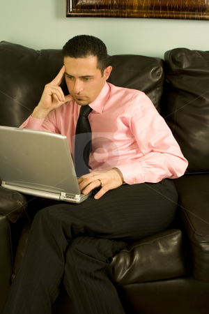 Businessman Working on the Couch stock photo, Businessman Working on his Laptop by Mehmet Dilsiz