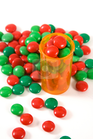 Medicine Bottle filled with Candy  stock photo, Medicine Bottle filled with Candy - Tastes like Candy Concept by Mehmet Dilsiz