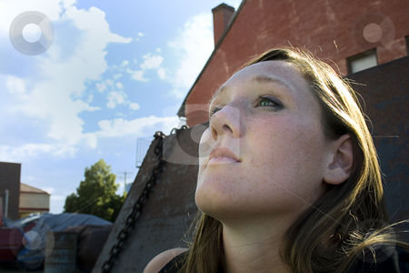 Close up on a Girl Looking Up - Urban stock photo, Close up on a Girl Looking Up in an Alley- Urban by Mehmet Dilsiz