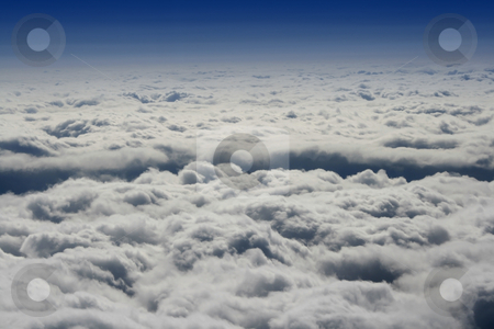 Clouds from the Plane stock photo, Clouds around the mountain by Mehmet Dilsiz
