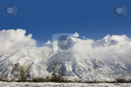 Mountains in Winter stock photo, Snowy Mountains in Winter by Mehmet Dilsiz