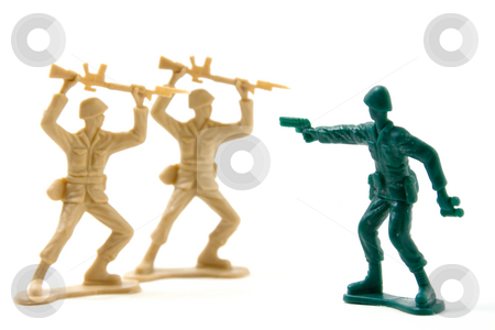 Courage - Two on One Plastic Soldiers stock photo, Isolated Plastic Toy Soldiers - Courage Concept by Mehmet Dilsiz
