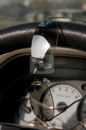 Sunglasses on the steering wheel stock photo, Reflection on the sunglasses on the steering wheel by Mehmet Dilsiz