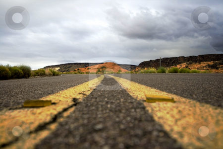 Close up on a road in Snow Canyon Park stock photo, Road on the Snow Canyon in St. George, Utah by Mehmet Dilsiz