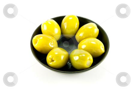 Olives in a Bowl stock photo, Green olives in a small round black bowl on a white background by Keith Wilson