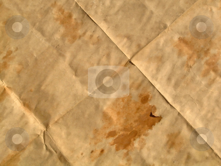 Wrinkled papyrus stock photo, Piece of an old brown paper with wet spots which has been combined by squares. by citcarsten