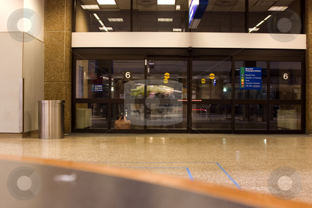 Airport Doors stock photo, Glass windows at the airport by Mehmet Dilsiz