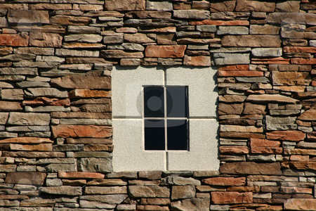 Rock Wall with Concrete Window stock photo, Rock Wall with Concrete Window in the middle by Mehmet Dilsiz