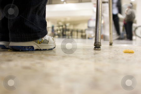 Floor view on a kid waiting at the airport stock photo, Floor view on a kid waiting at the airport with his onion ring on the floor by Mehmet Dilsiz