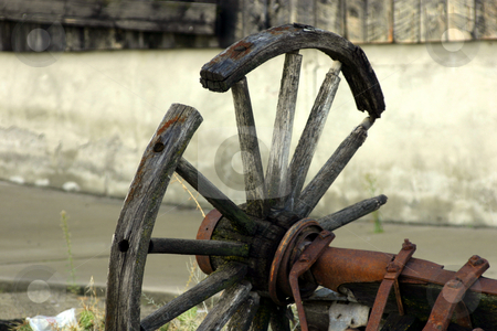 Broken Old Antique Wagon Wheel stock photo, Broken Close up on an Old Antique Wagon Wheel by Mehmet Dilsiz