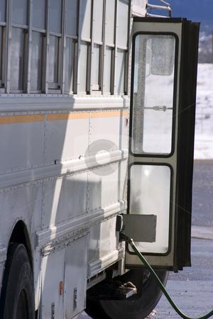 White School Bus Pumping Gas stock photo, White School Bus Pumping Gas by Mehmet Dilsiz