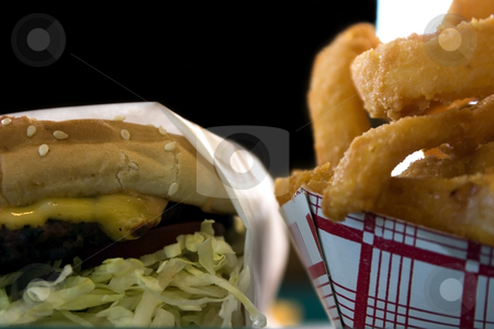 Close up on Onion Rings and a Hamburger stock photo, Close up shot of Onion Rings and a Hamburger by Mehmet Dilsiz