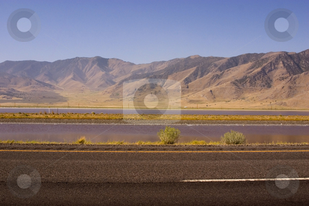 Highway with Mountains on the Background stock photo, Highway with Mountains on the Background and a Stream between the lanes by Mehmet Dilsiz