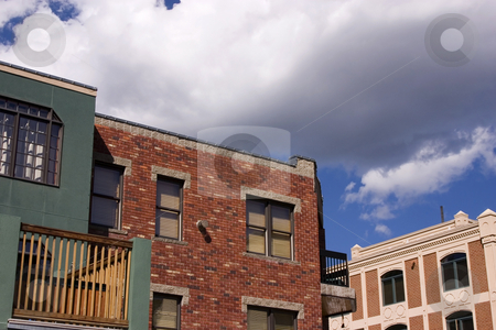 Close up on an Old Building with Cloudy Background stock photo, Old Colonial Buildings in Park City, Utah by Mehmet Dilsiz