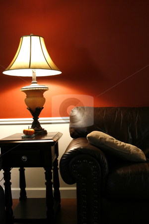 Lamp and the Couch - Vertical Shot stock photo, Close up on a Lamp and the Coush in a House by Mehmet Dilsiz