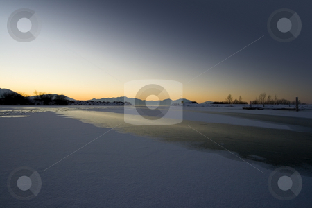 Sunrise over the Frozen Lake stock photo, Sunrise over the Frozen Lake in Winter by Mehmet Dilsiz