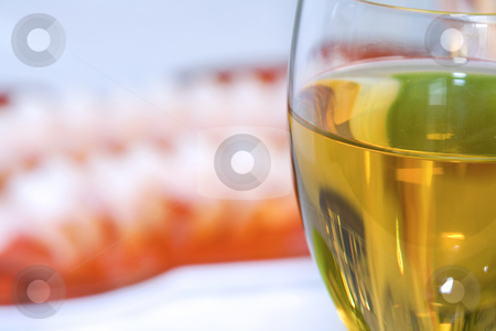 Shrimps on a Plate with the Wine Glass in Focus stock photo, Close up - Shrimps on a Plate with the Wine Glass in Focus by Mehmet Dilsiz