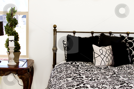 Close up on a Bedroom  stock photo, Close up on a bed in a bedroom by Mehmet Dilsiz