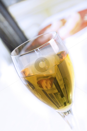 Close up on a Wine Glass with Blurry Background stock photo, Angle Shot of a Wine Glass with Blurry Background Overblown Highlight by Mehmet Dilsiz