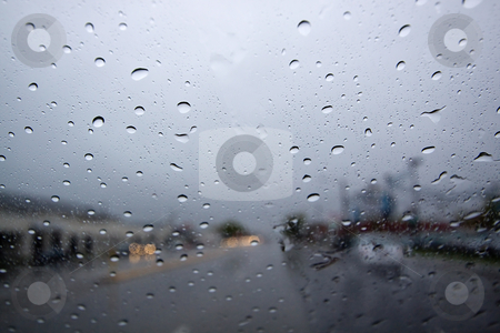 Raindrops stock photo, Raindrops on the Windshield by Mehmet Dilsiz