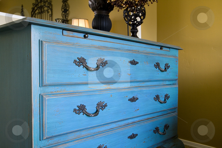 Close up on the drawers of a dresser stock photo, Close up on a blue dresser by Mehmet Dilsiz