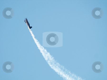 Airplane during airshow stock photo, Aircraft  performing during airshow with trail by Laurent Dambies
